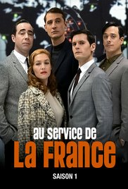 5 people all dressed smartly in the background facing the camera with the title of the tv series in the foreground