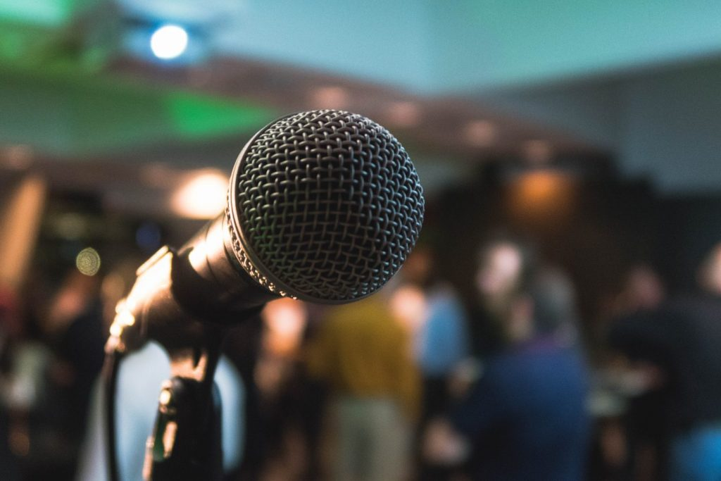 Standup comedy- Photo by Kane Reinholdtsen on Unsplash