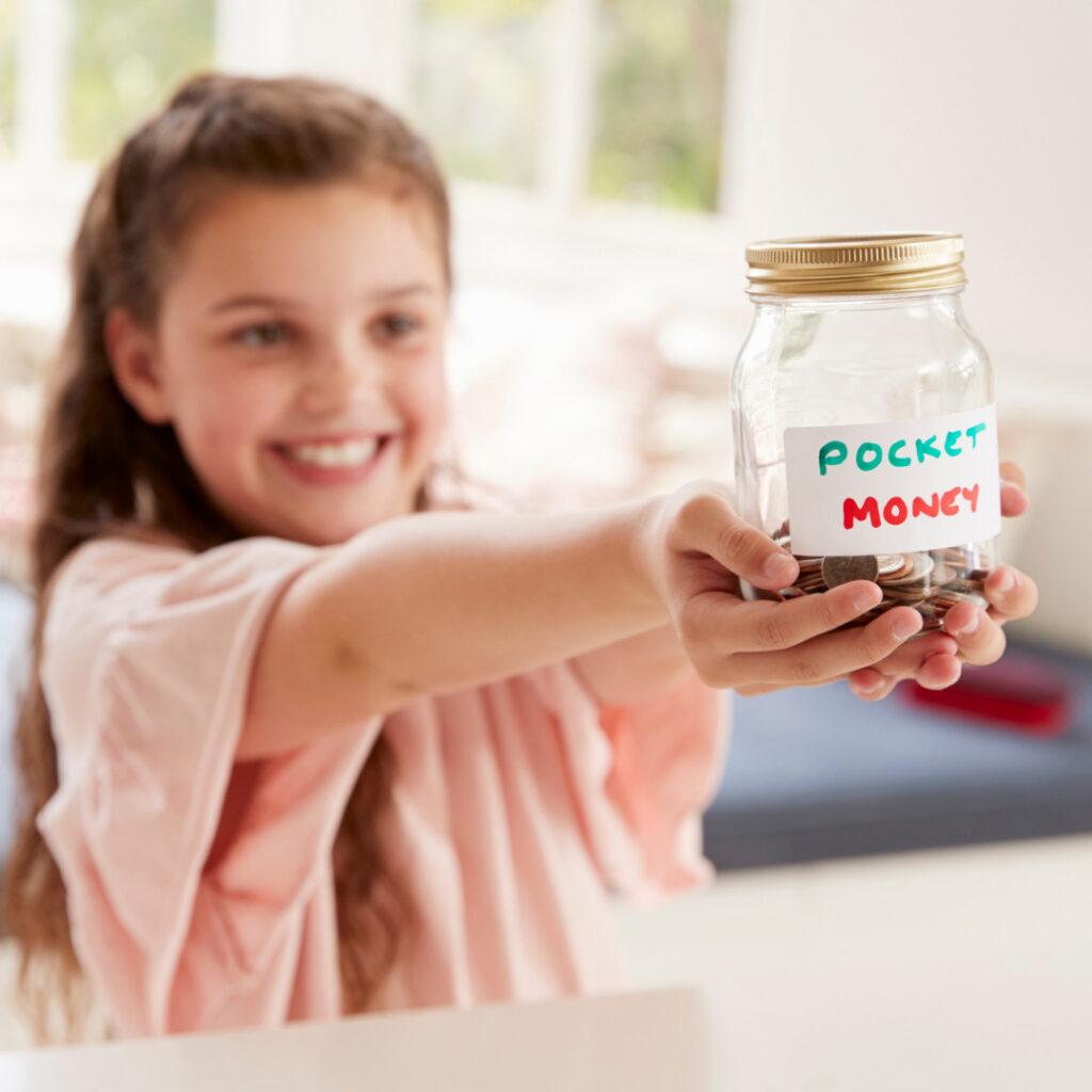 Young girl saving pocket money