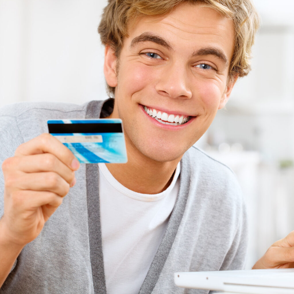 Young man using student discount card