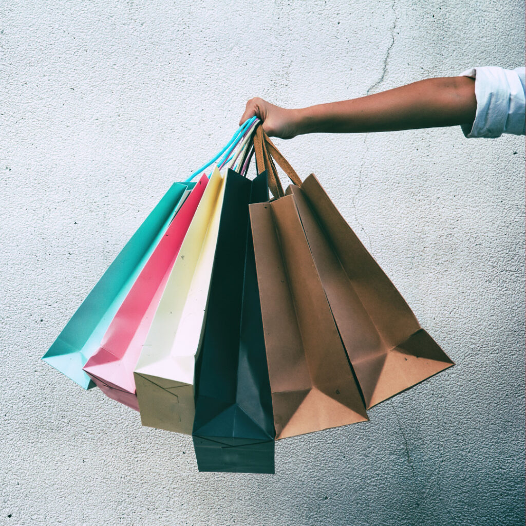 Woman holding plenty of shopping bags