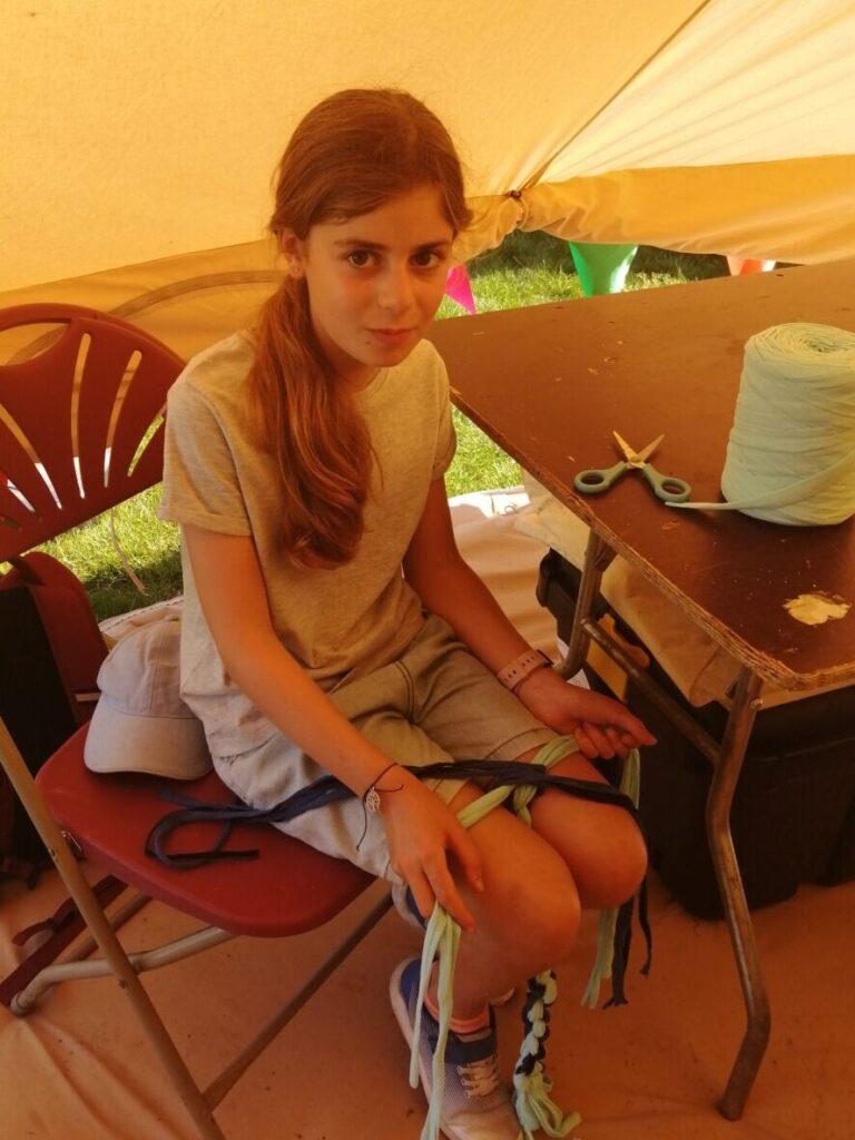 Mia making poi at Summer of Smiles