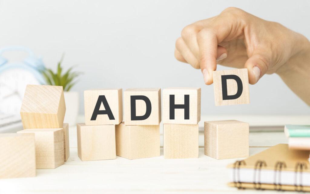 ADHD Abbreviation on ADHD cubes on a light background.
